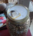 Saltbox top on jar of plant food